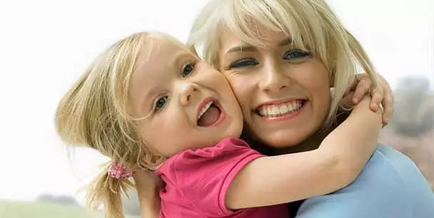 Happy mother and young daughter