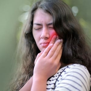 Young woman in pain from a toothache